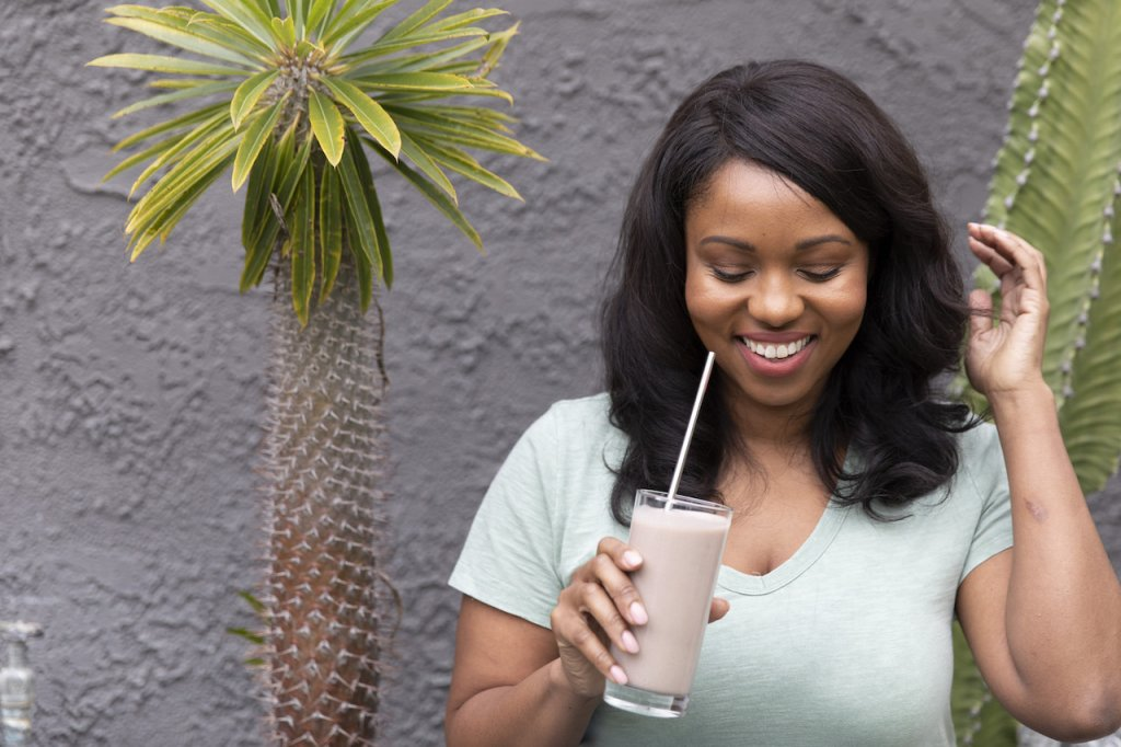 A woman drinking a shake