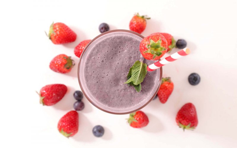A colorful shake with blueberries and strawberries