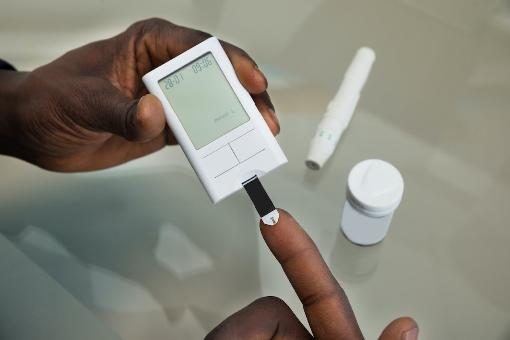 An image of a person testing their blood sugar