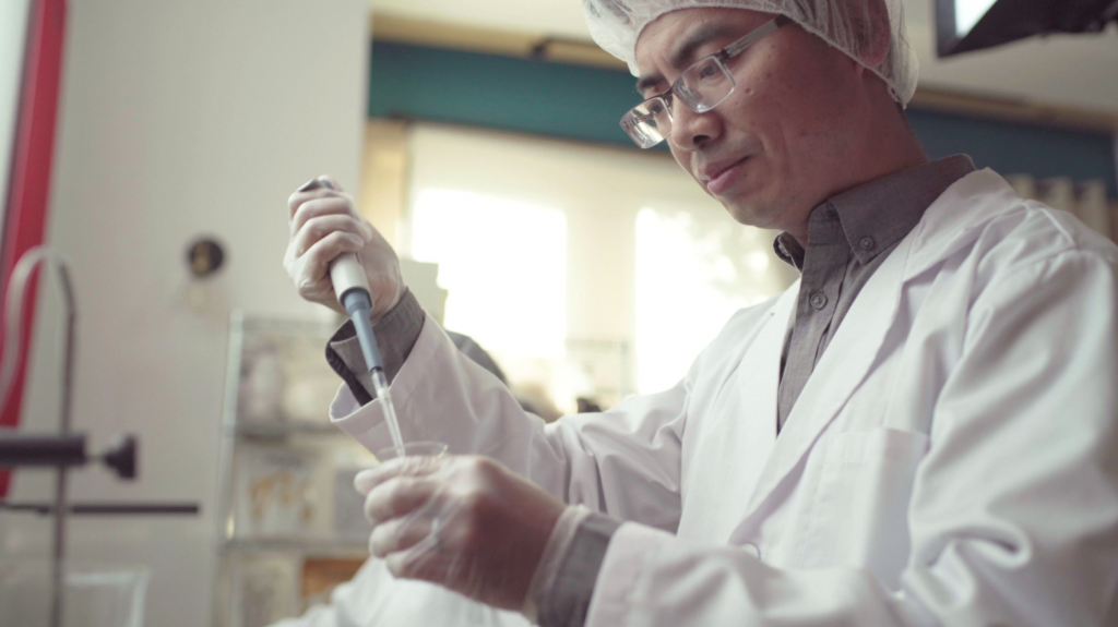 An image of a man in a lab coat