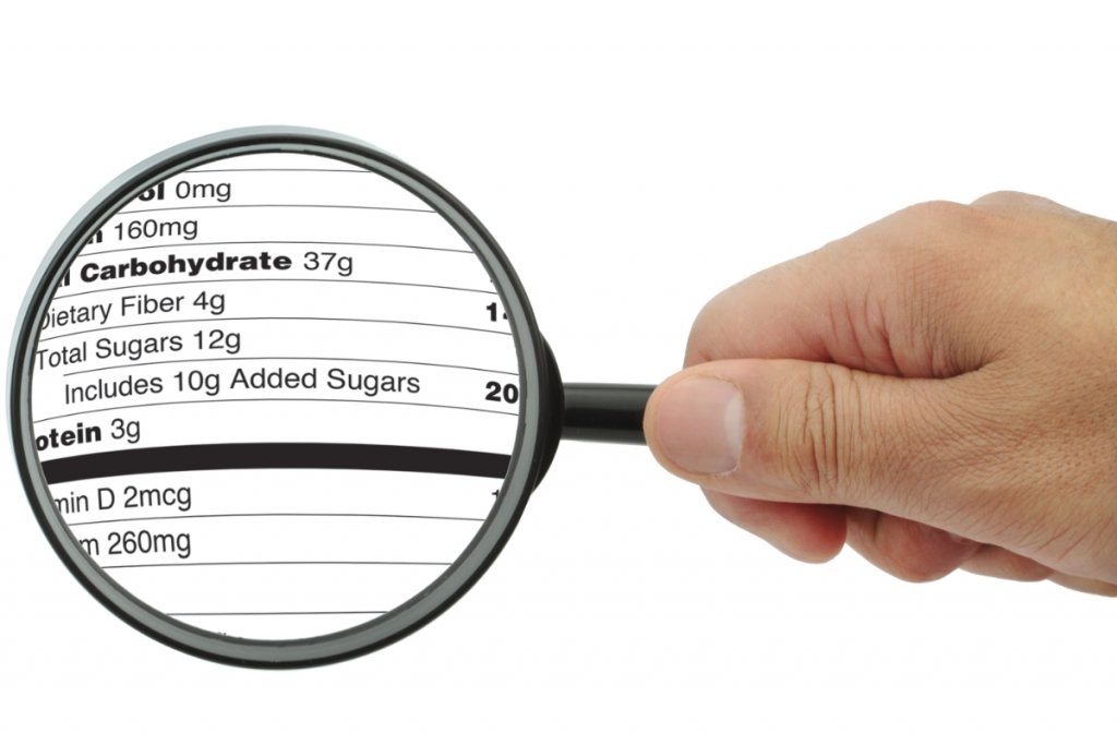An image of a magnifying glass over a nutrition panel