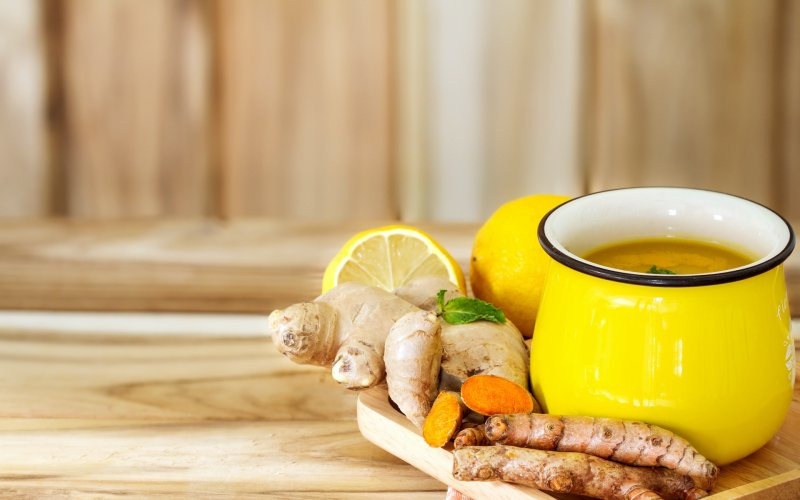 A picture of tea in a yellow mug with ginger