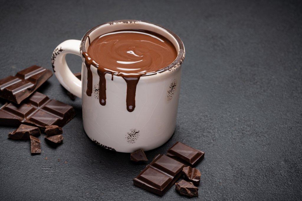 A photo of a creamy hot chocolate in a mug