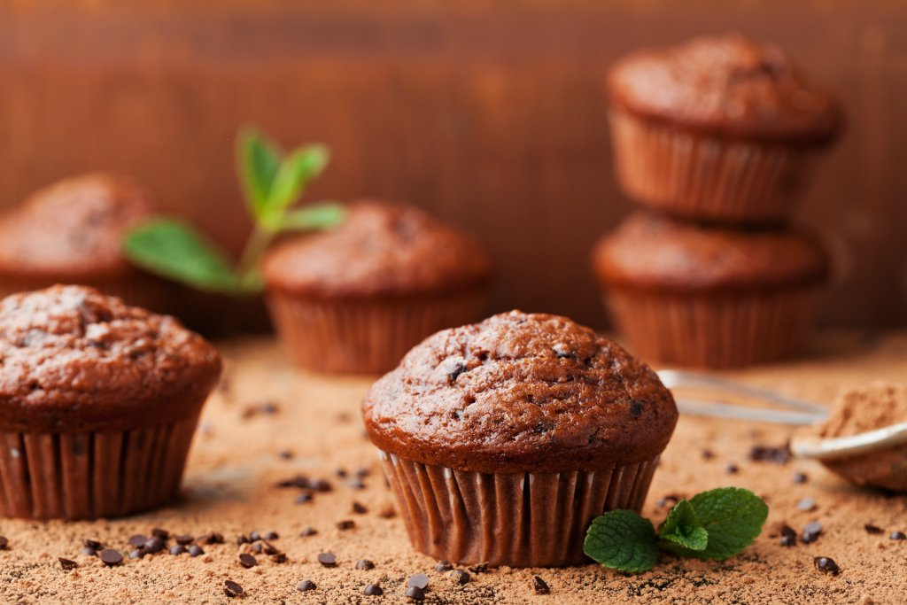 Chocolate banana bread muffin on brown background