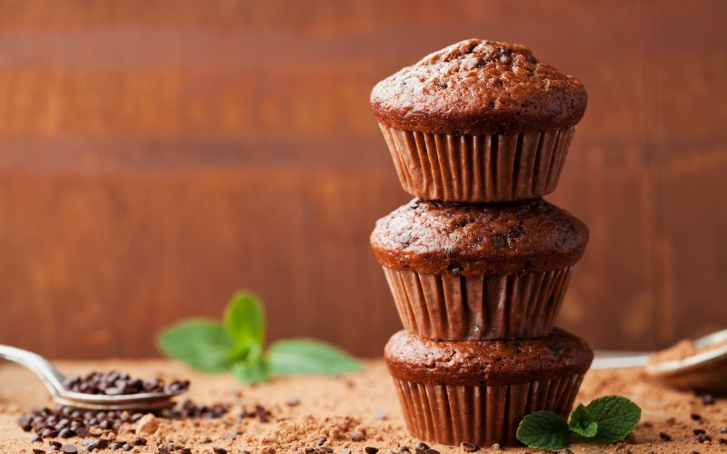 An image of 3 chocolate banana bread muffins stacked