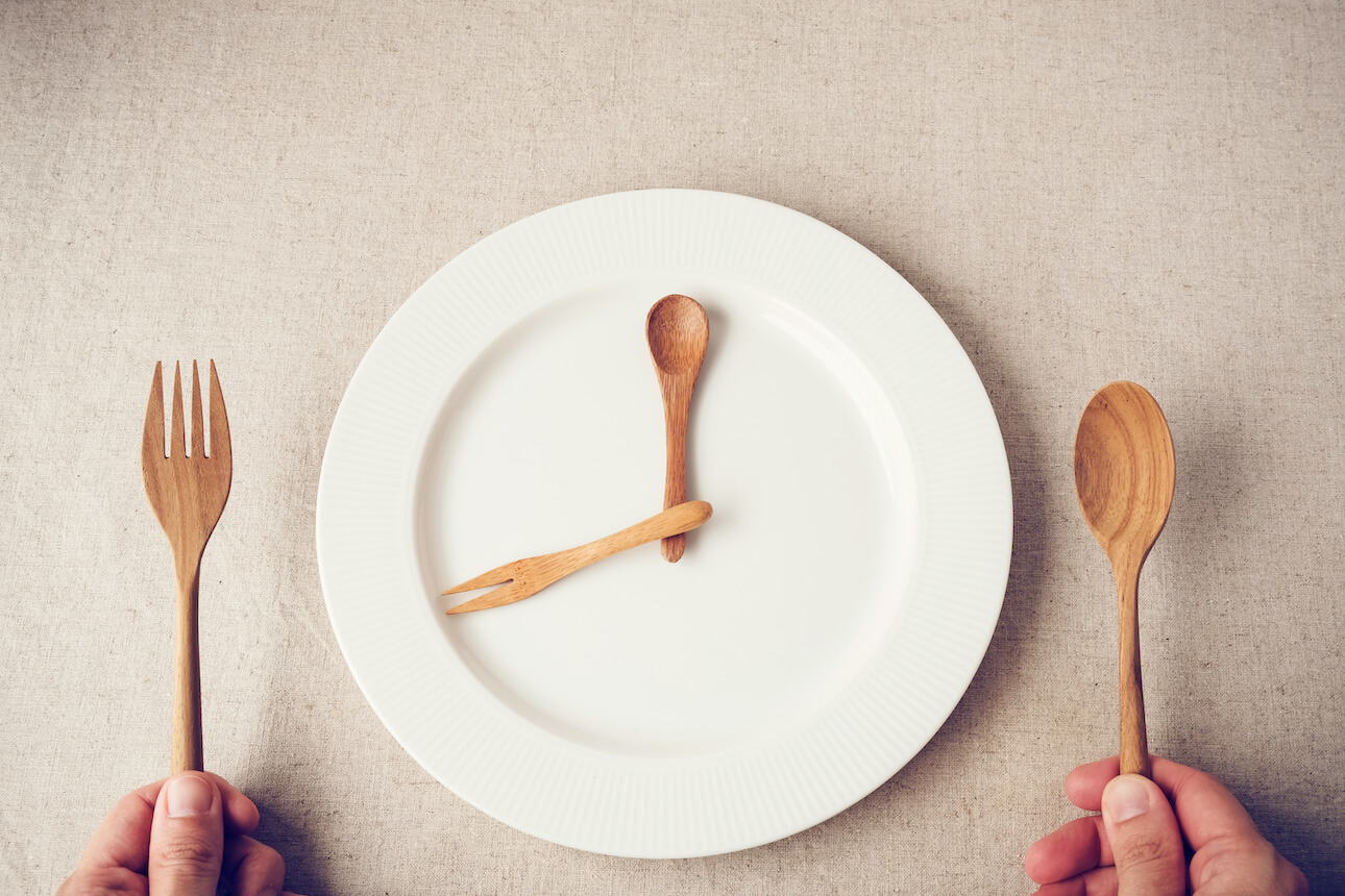 An image of wood cutlery on an empty plate